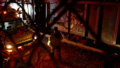4K UHD - Paramedic looking at dead body under train at night Stock Footage