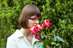 Young wooman with roses Stock Photos