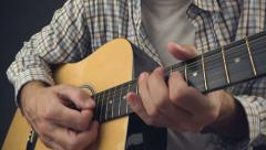 Man playing rock tune on acoustic guitar Arkistovideo