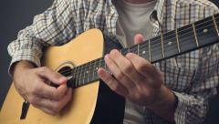 Man playing solo tune on acoustic guitar Stock Footage