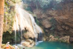 Blurry defocused image of waterfall in rural thailand for background Stock Photos