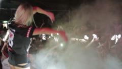 Performer on the stage dancing with the crowd (left-right and jump) Stock Footage