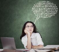 Cute schoolgirl with web icons - stock photo