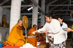People offer rice on buddhist monk alms bowl Stock Photos