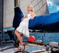 Stylish wealthy woman on a luxury yacht - stock photo