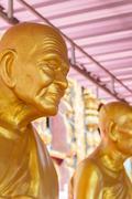 golden buddhism monk statue - stock photo