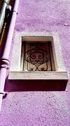 Stock Photo of Window frame in Burano on purple color wall