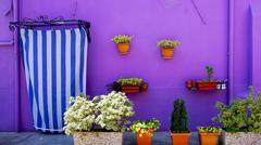 Stock Photo of Burano purple wall color house