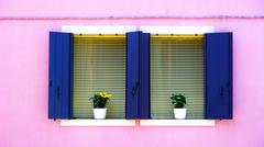 Stock Photo of Two blue Windows on pink color wall
