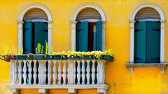 Stock Photo of two Doors and terrace in Burano on yellow color wall