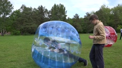 Children boys try zorbing zorb bubbles balls recreation. 4K Stock Footage