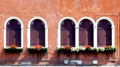 Stock Photo of five wooden windows and ancient decay wall