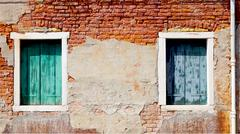 Two windows and ancient decay brick wall Stock Photos