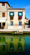 building architecture in Murano with reflection - stock photo