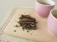 Herbal tea with liquorice root - stock photo