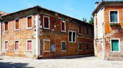 old brick building architecture in Murano - stock photo