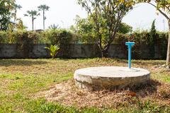 underground cement cylinder of lavatory cesspit - stock photo