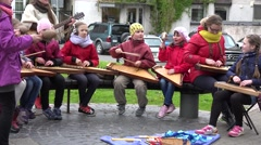 Girls and teacher play with baltic psaltery instruments. 4K Stock Footage