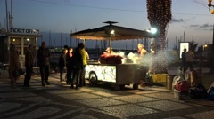 4k People at chestnut stand after sunset in Funchal harbor Madeira Stock Footage