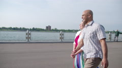 Walking with couple in slow motion by the Detroit River 4K - stock footage