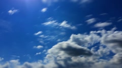 Sun's rays shine through the clouds, time lapse Stock Footage