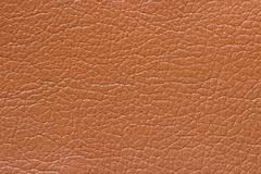 Synthetic brown leather texture or background - stock photo