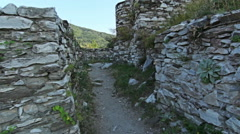 Steady cam, walking through UNESCO old century castle stronghold in the mountain - stock footage