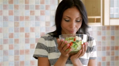 Housewife in kitchen with salad Stock Footage