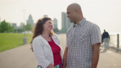 Happy couple talking in morning by the Detroit River 4K - stock footage