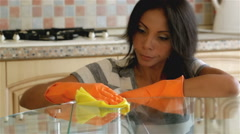 Housewife cleaning table in the kitchen - stock footage