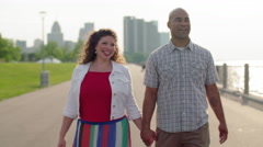 Happy couple stop to talk by the Detroit River 4K Stock Footage