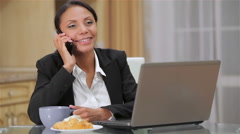 Beautiful business woman working at home Stock Footage