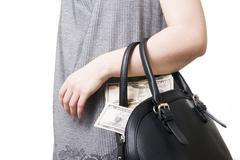 Woman with a bag full of money in the hands of - stock photo
