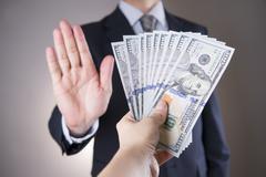Businessman with money in studio. Corruption concept Stock Photos