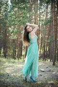 Portrait of a beautiful sexy woman in green dress on nature Stock Photos