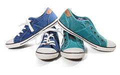 Blue and green canvas sneakers - stock photo