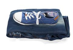 Jeans and blue sneakers - stock photo