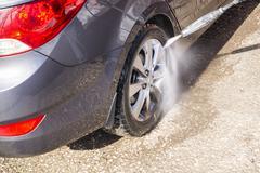 High pressure manual car washing - stock photo