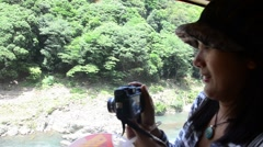 Thai woman on Sagano Scenic Railway in Arashiyama, Kyoto, Japan Stock Footage
