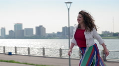 Woman runs to meet her date in Detroit 4K Stock Footage