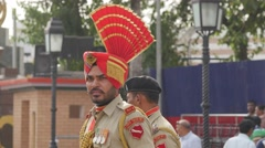 Border guard at flag lowering ceremony,Wagah,Punjab,India Stock Footage