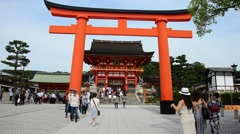 People and traveler travel and walking to inside at Fushimi Inari Shrine Stock Footage