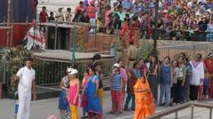 Ladies run with flag to pakistan border,Wagah,Punjab,India Stock Footage