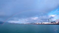 Brilliant rainbow over Reykjavik Harbor, Iceland Stock Footage