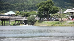 Togetsukyo Bridge across the Oi River in Arashiyama, Kyoto, Japan Stock Footage