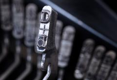 D hammer - old manual typewriter - cold blue filter - stock photo