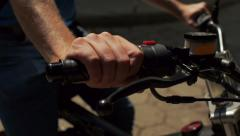 Man checks motorbike handle. Stock Footage