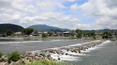 Togetsukyo Bridge across the Oi River in Arashiyama, Kyoto, Japan Stock Footage