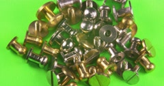 Metal bags buttons, rivets set. Isolated on green background. Stock Footage
