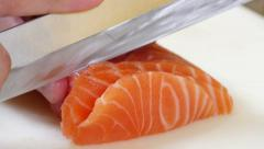 Sushi Chef Slicing a Salmon Steak Nigiri Style Stock Footage
